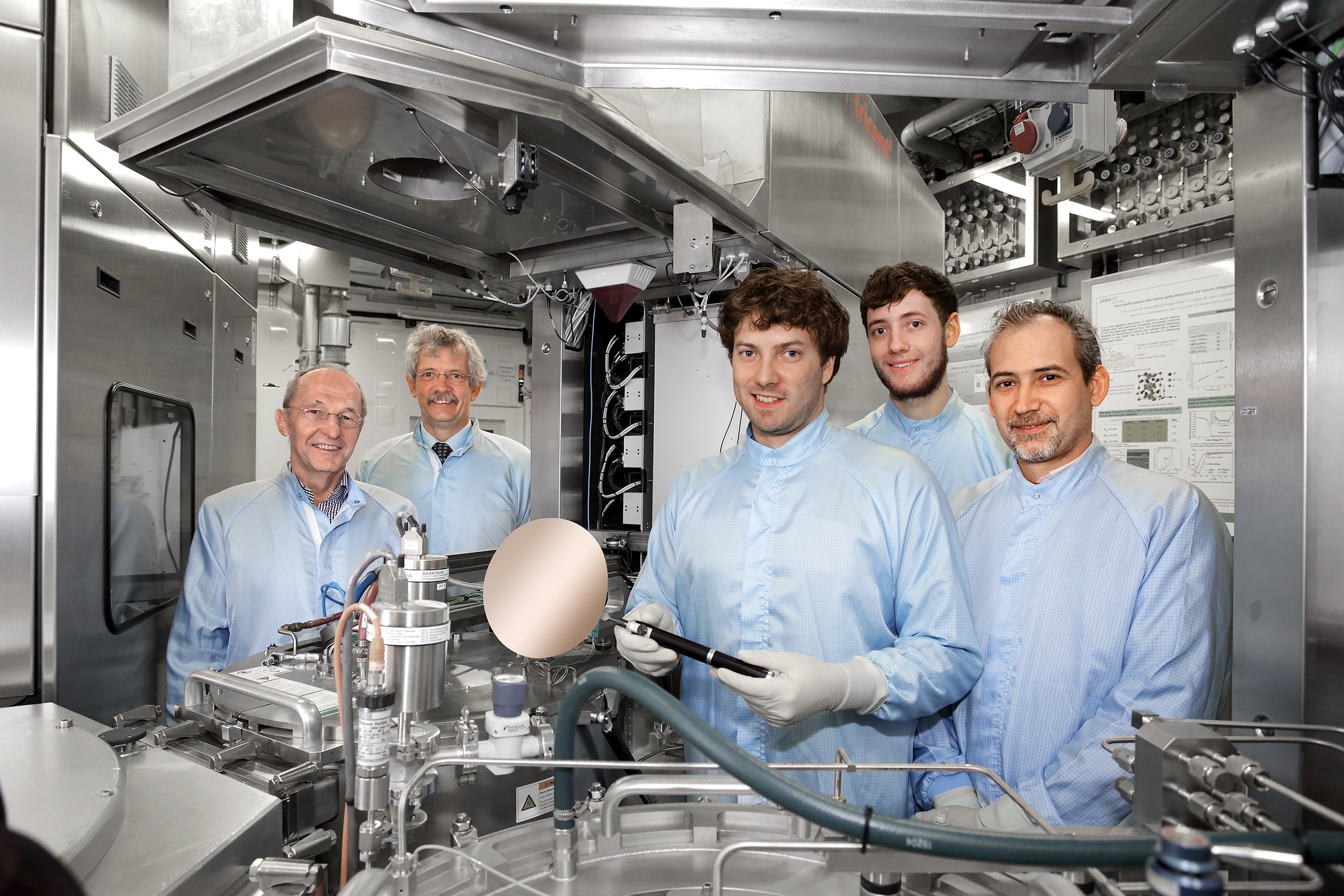 Scientists from the Peter Grünberg Institute (PGI-9) standing next to a CVD system which was used to prepare and develop parts of the new laser (from left: Prof. Siegfried Mantl, Prof. Detlev Grützmacher, Stephan Wirths, Nils von den Driesch and Dr. Dan Mihai Buca). (Copyright: Forschungszentrum Jülich)