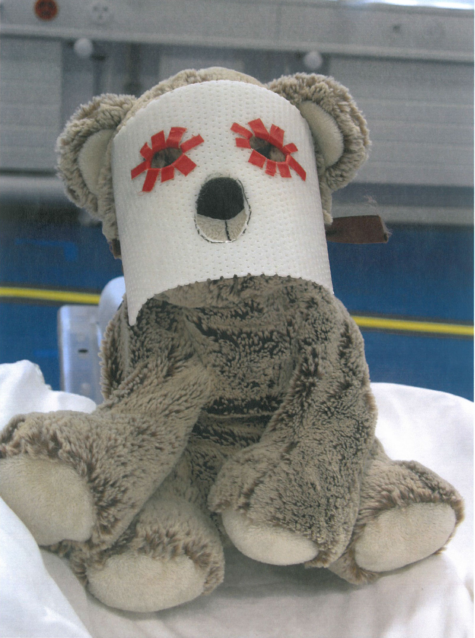 Individual masks are constructed for children receiving proton treatment to the head. The mask ensures that the child's head stays in the same position during each irradiation session. In order to make the mask less frightening, a small replica is made for the patient's favourite teddy, which sits next to the child during irradiation. (Photo: Paul Scherrer Institute)