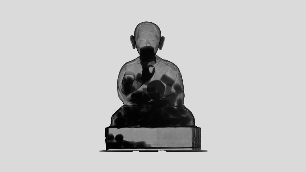 Tibetan figure, made of bronze and silver. This neutron image renders visible the many small scrolls with Buddhist texts which are hidden inside the hollow statue. (Image: Paul Scherrer Institute / Neutron Imaging and Activation Group)