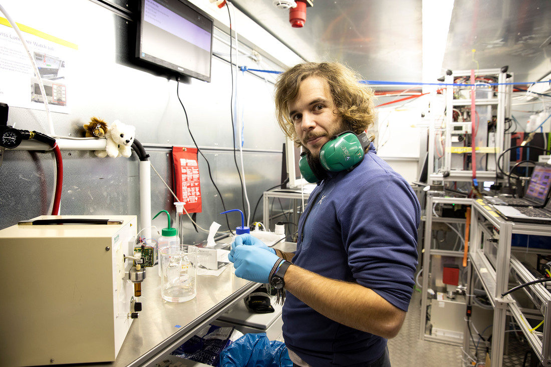Andrea Baccarini doing lab work in a container on board the research vessel