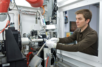Beamline scientist Vincent Olieric mounts a protein crystal sample for measurement at SLS.