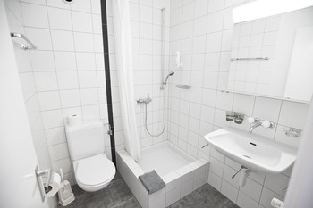 Certain rooms contain a private bathroom with shower and toilet.