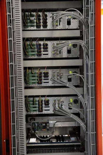 "Cabling in 19""-cabinet, if so we see several controller connected to 24 axis consisting of motor, encoder an other IO's."