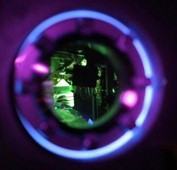 Pilot experiment at Alvra beamline of SwissFEL. View inside the chamber. Green fluorescence from Cu-based OLED complexes excited with UV light.