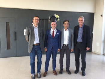 Pablo Corral and the thesis committee after the defense: Matthias Arenz (Uni. Bern), Pablo Corral, Markus Ammann (PSI), and Andreas Türler (Uni. Bern)