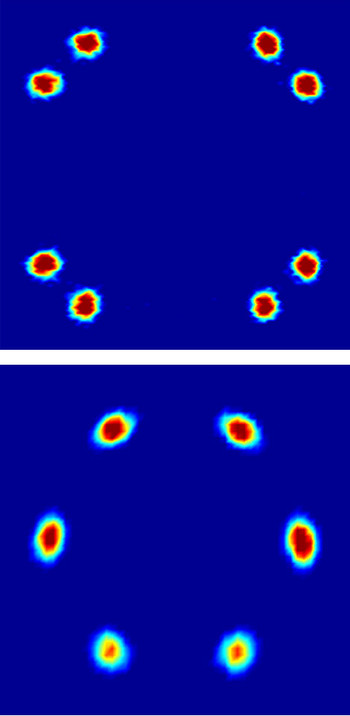 Neutron scattering diagrams reflecting the arrangement of the flux lines in a superconductor. In the experiment, a beam of neutrons passes through the superconductor and part of the neutrons are deflected (scattered) in various directions by the arrangement of flux lines. The colour in the diagrams reflects the number of neutrons scattered in the particular directions (blue – few neutrons, red – many neutrons). Both diagrams were recorded at the same conditions except for the orientation of the sample.