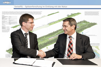 Joël Mesot, PSI Director, and Peter Limacher, CEO of ALPIQ InTec AG, at the signing of the general contractor's contract for work and services.
