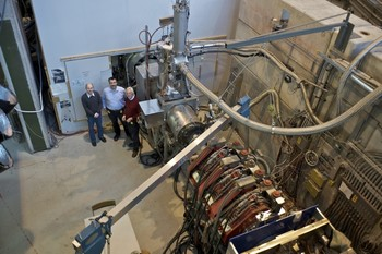 "What Stefan Ritt (centre) calls a ""dinky little experiment"". Although seemingly large, compared to the giant detectors at CERN, this description is more than apt.   (Photo: Markus Fischer / PSI)"