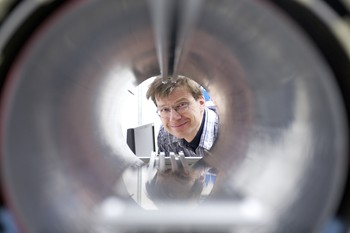 Klaus Kirch, Head of the Laboratory of Particle Physics at PSI, at a test setup for the measurement of the neutron electric dipole moment. The researchers have devised a new method to measure ultra-cold neutrons, which may help to explain why considerably more matter than antimatter was formed during the Big Bang. (Photo: PSI)