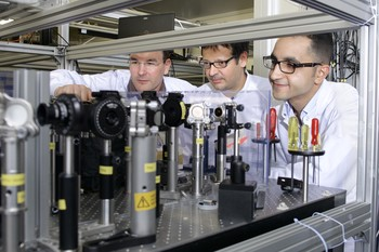 PSI researchers Christoph Hauri, Carlo Vicario and Mostafa Shalaby (from left to right) in the laser laboratory at PSI. The terahertz laser developed at PSI is currently the world's most intensive source of terahertz light. (Photo: Paul Scherrer Institute/Markus Fischer)
