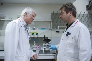Walter Hirzel (left), head of the Radionuclide Production and Maintenance Group, and his colleague Alexander Sommerhalder in the laboratory on the premises of PSI West. The substances from which artificial radionuclides are produced are prepared here. (Photo: Paul Scherrer Institute/Mahir Dzambegovic)