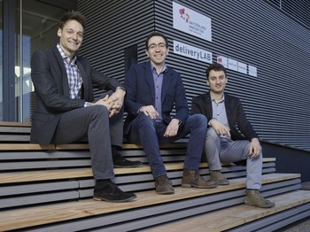 The InterAx Biotech team: Luca Zenone, Martin Ostermaier, and Aurélien Rizk in front of the PARK INNOVAARE pavilion. (Photo: Scanderbeg Sauer Photography)