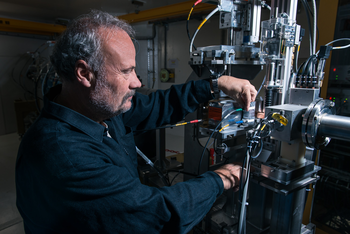 Physicist Martin Grossmann checks a security element in the beam path behind the proton irradiation facility Gantry 3. (Photo: Paul Scherrer Institute/Mahir Dzambegovic)
