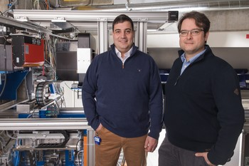 PSI researchers Christian Grünzweig (left) and David Mannes at the experimental setup with neutron beams where the images illuminating the interior of pre-filled syringes were produced. (Photo: Paul Scherrer Institute/Mahir Dzambegovic)