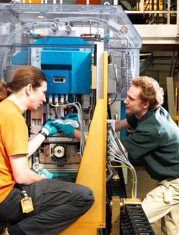 Two scientists preparing a neutron scattering experiment at one of the SINQ user instruments.